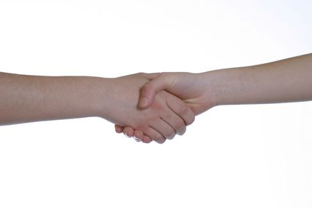 two caucasians shaking hands on white background photo