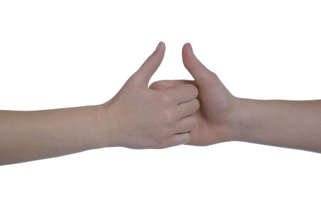 two caucasian hands on white space in a game of thumb wars photo