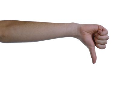 caucasian hand giving thumbs down signal on white background photo