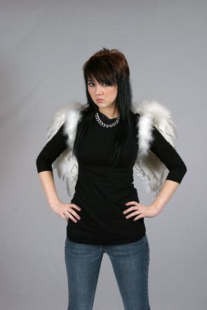 urban girl in black with angel wings photo