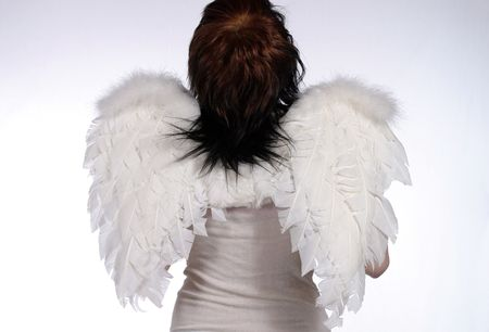 girl dressed as angel looking toward heaven photo