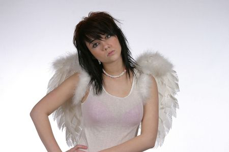 pretty brunette dressed as angel looking into camera photo