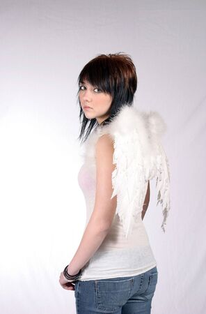 pretty brunette dressed as angel looking over shoulder photo