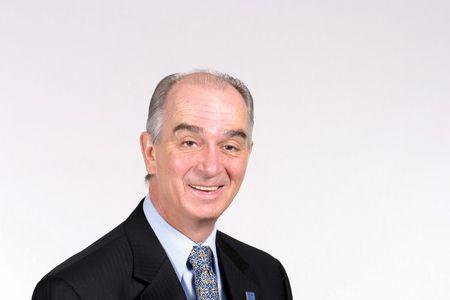 Senior caucasian man in suit smiling