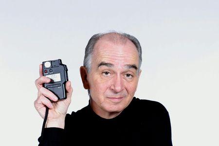 Elderly man on white background holding light meter Stock Photo - 776115