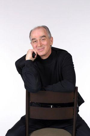 attractive elderly caucasian man smiling on white background Stock Photo