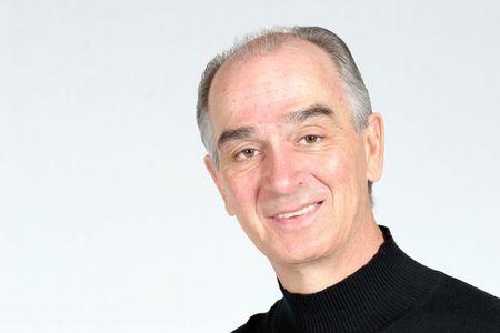 elderly man in black smiling on white background Stock Photo