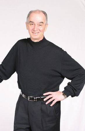 mature man with gray hair dressed in black on white background photo
