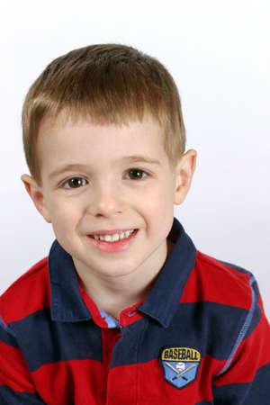 cute boy with big brown eyes smiling