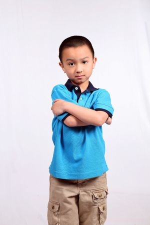 asian boy with arms crossed isolated on white Stock Photo
