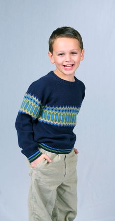 cute little caucasian boy with brown eyes laughing