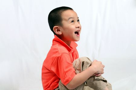 laughing asian boy isolated on white