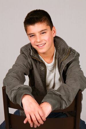 studio shot of cute preteen boy in casual clothes Stock Photo
