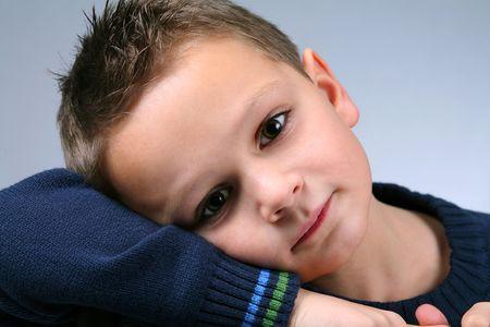 Closeup of sad, cute little caucasian boy Stock Photo