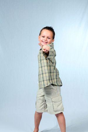 Full lenfth shot of cute little boy in shorts Stock Photo