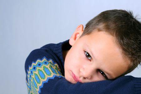 Closeup of sad, cute little caucasian boy