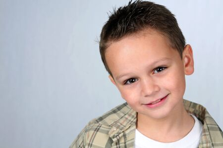 Closeup of cute little caucasian boy smiling
