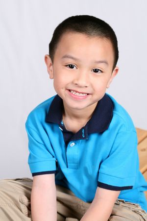 little asian boy smiling isolated on white