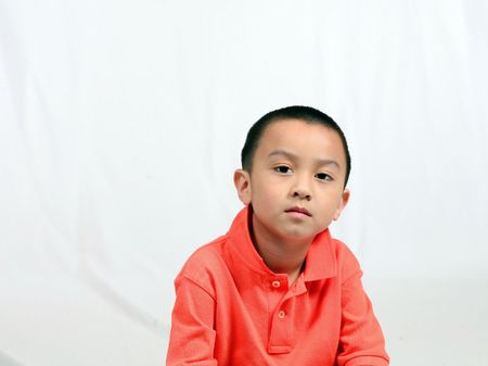 serious asian boy isolated on white background