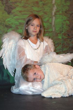 adorable young boy and girl dressed as angels Stock Photo - 3054934