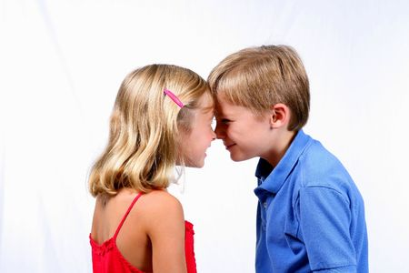 adorable boy and girl nose to nose smiling 版權商用圖片