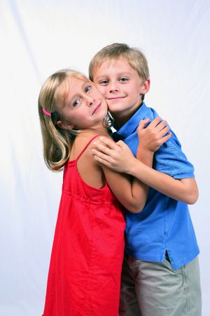 average guy: cute blond boy and girl hugging Stock Photo