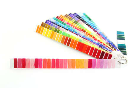 pantone: Pantone swatch of colorful thread ,focus on the front red pantone on white background