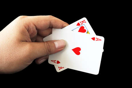 black jack: Black Jack of heart in playing cards game in the hand on a black background