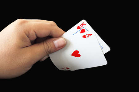 black jack: Black Jack two card of heart in playing cards game in the hand on a black background