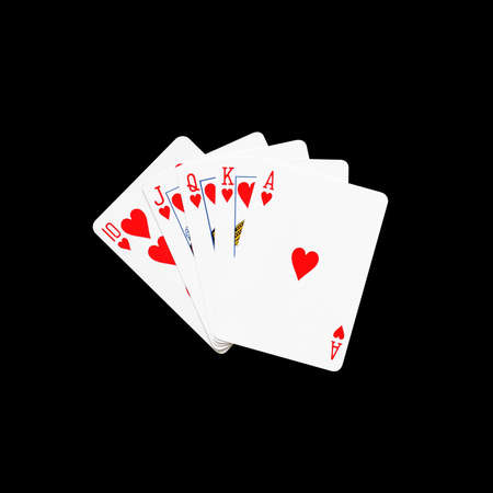 royal flush: Royal Flush of heart in poker game on a black background