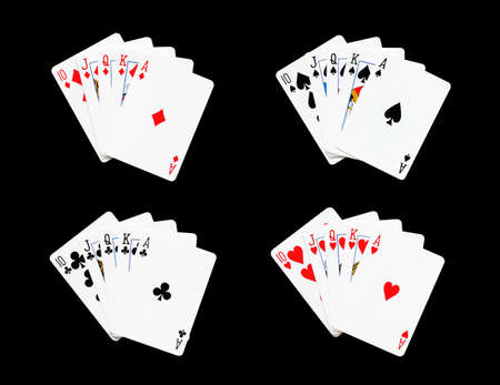 royal flush: Royal Flush of spade,heart,diamonds,clubs in poker game on a black background