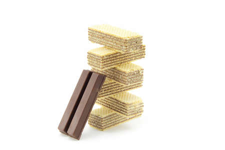 multi layered: Wafer Snacks with a mixture of chocolate and chocolate bars. Putting together a multi layered on white background
