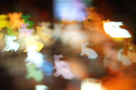 lapin silhouette: Colorful forme de lapin bokeh, l'art des lumi�res de la nuit