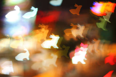 lapin silhouette: Multicolour bokeh rabbit shape ,the art from night lights Banque d'images