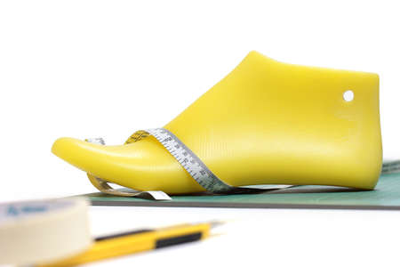 Last shoe and equipment used in shoe design on white background , focuses on the last shoe.(with clipping path)