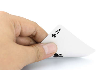 focuses: Closeup photos that focuses on the ace card of clubs in the hand on white background