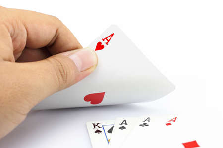 focuses: Closeup photos that focuses on the ace of heart in hand,in poker game on white background Stock Photo