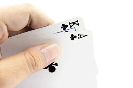 focuses: Closeup photos that focuses on the black jack with King card and ace card of clubs in the hand on white background Stock Photo