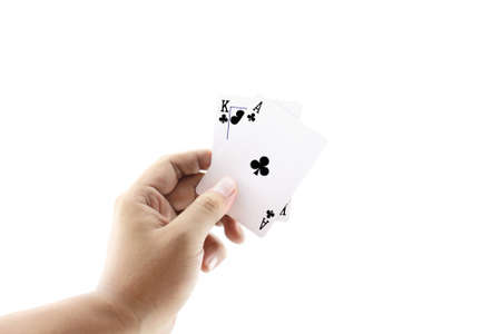 jack of clubs: Black Jack two card of clubs in playing cards game in the hand on a white background ,focused on cards