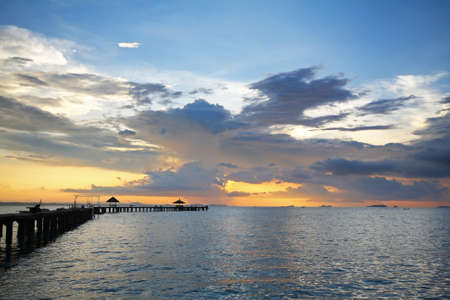 rayong: Beautiful colors of the sky and clouds during sunrise and The silhouette of the bridge at Rayong Resort.,Rayong province in Thailand