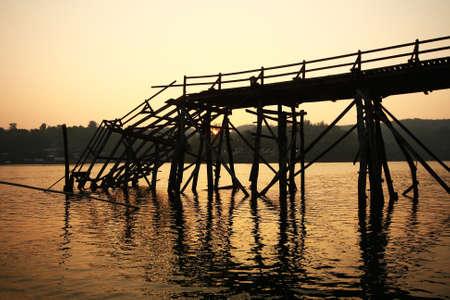 sangkhla buri: Old dilapidated wooden bridge in name Mon Bridge broken down in the river at the Sangkhla Buri district ,Kanchanaburi province in Thailand