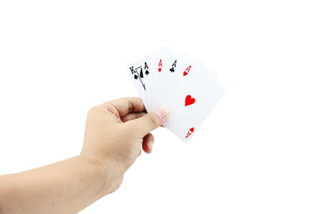 focuses: Closeup photos that focuses on The Four of a kind card with King card and ace four card of poker game in the hand on white background Stock Photo