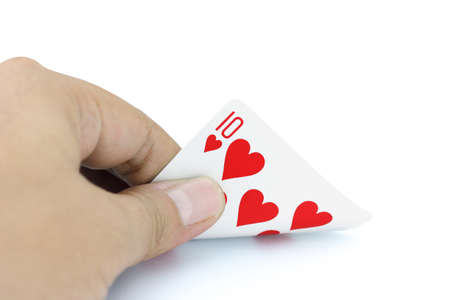 focuses: Closeup photos that focuses on the ten card of heart in the hand on white background