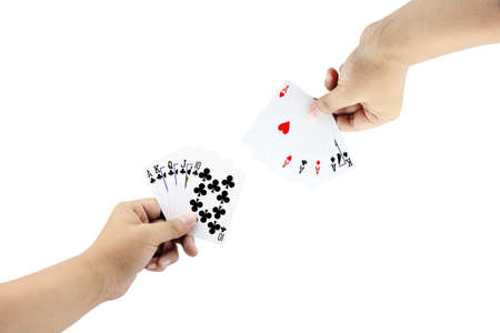 straight flush: The battle between Royal Straight Flush of clubs and Four of a kind in poker game on white background,Focused on card Stock Photo