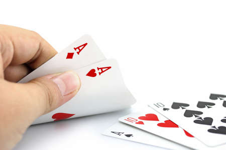 focuses: Closeup photos that focuses on two card of ace in hand,in poker game on white background Stock Photo