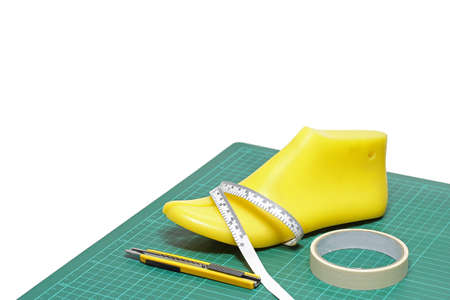 focuses: Last shoe and equipment used in shoe design on white background , focuses on the last shoe.(with clipping path)