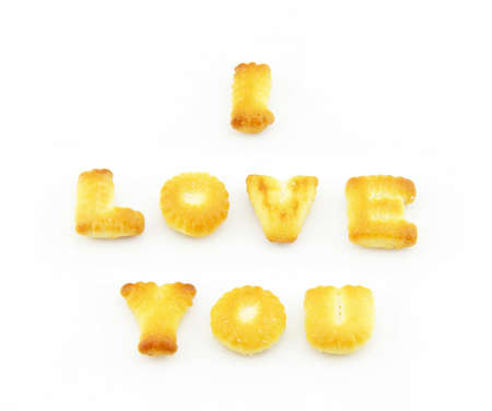 english text: English text the words I love you made �??�??of biscuits on a white background.