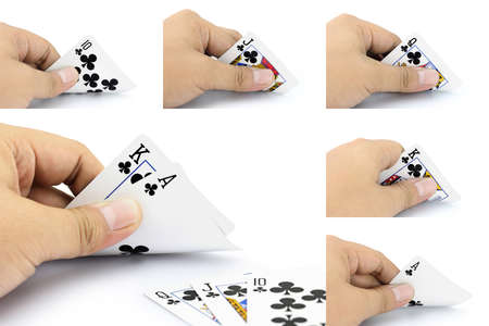 focuses: The combination of cards will come as a great piece of Royal Straight Flush of clubs in poker game, Focuses on card in the hand Stock Photo
