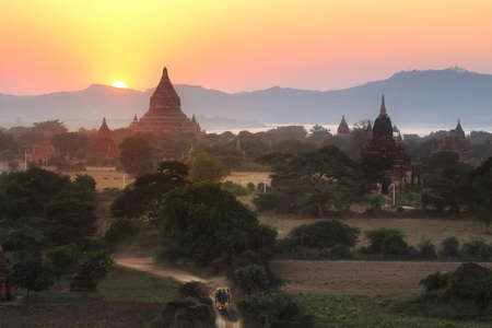 beautiful location: Sunset behind the pagoda at Bagan in Myanmar,is a beautiful location and very popular for photographers and tourists. Religion and attraction Concept Stock Photo