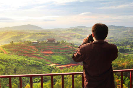 beautiful location: Photography of male photographer during sunrise at Khao Kho District ,Phetchabun Province in Thailand is a beautiful location and very popular for photographers and tourists Stock Photo